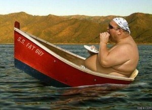 Fat guy in a boat from lolpix.com.